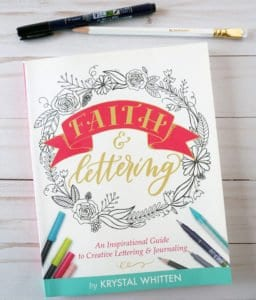 Faith and Lettering book with pen and pencil