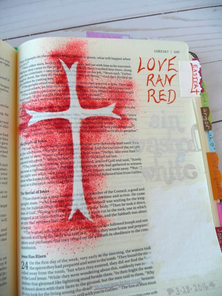Bible journal with red spray ink