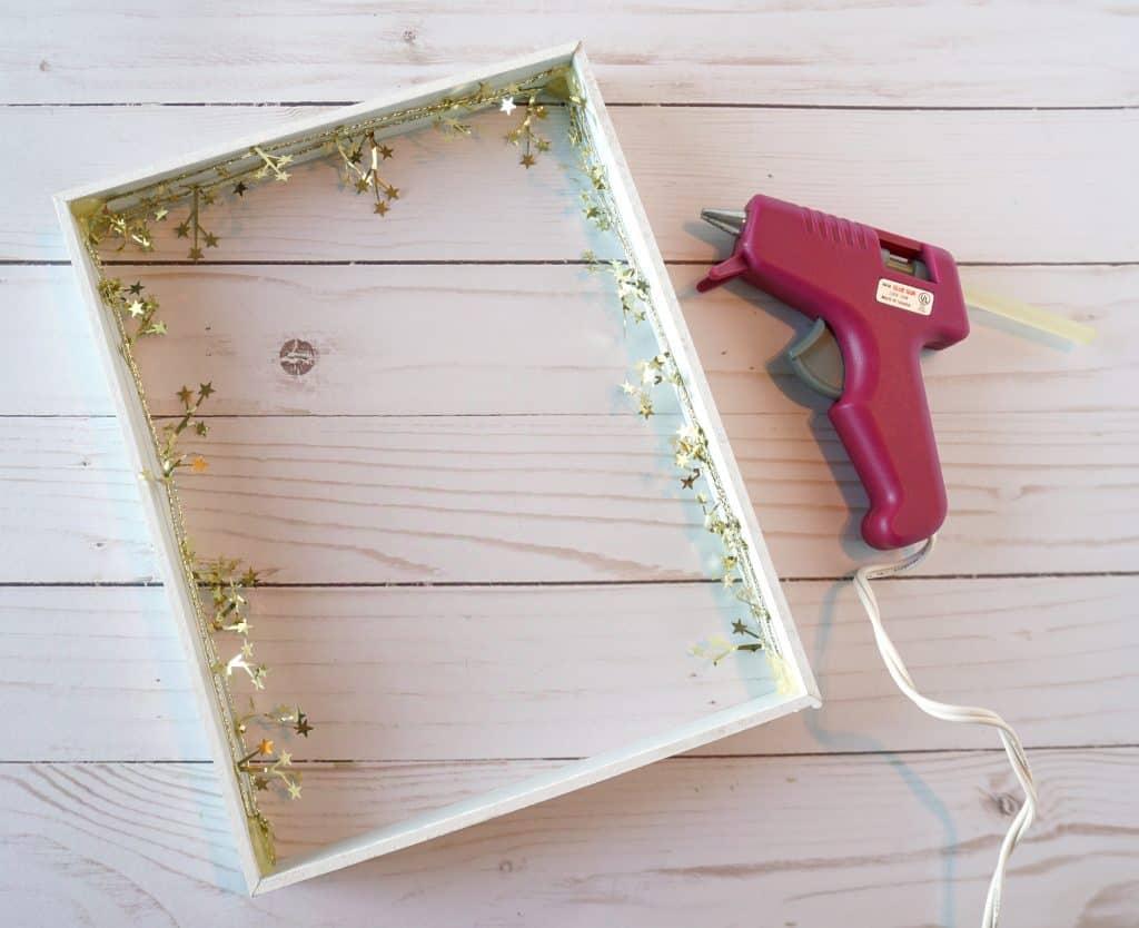 shadow box star garland and hot glue