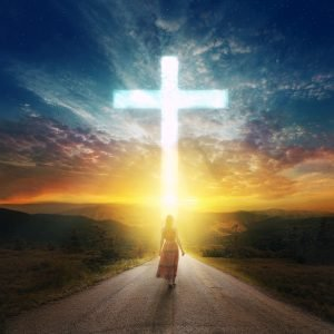 woman walking towards cross
